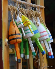 Colorful handcrafted buoys hang on a shop door in Bar Harbor, Maine, a perfect souvenir of a charming town. Beach Cottage Style, Cottage Style Homes, Coastal Style, Beach House, Coastal Art, Coastal Living, Lobster Trap, Shop Doors, Nautical Home