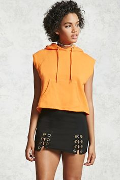 A knit mini skirt featuring lace-up grommets at the hem, and a concealed side zipper.
