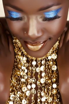I love the royal metallic blue eye shadow with the gold lips and accessories. Plus the skin has been dusted with gold shimmer for beautifully brilliant effect...