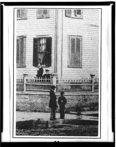 President Lincoln & Willie at fence of their Springfield IL home