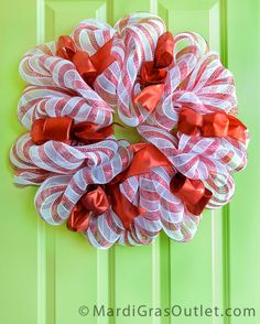 An updated version of the popular candy cane deco mesh wreath- A step-by-step how-to tutorial.