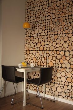 Wall decoration. Wood decoration. Wood slices. Bernhard chairs. Yellow lamp.