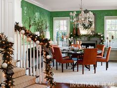 Emily Sullivan - Traditional Home Green de Gournay wallpaper takes center stage in this dining rom all decked out for the holidays.