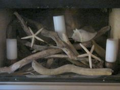 Summer fireplace....love the concept.  I'd leave out the shells though and use driftwood and candles