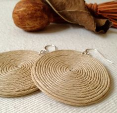 don't like them as earrings but would make killer coasters Hemp Jewelry, Fabric Jewelry, Clay Earrings, Polymer Clay Jewelry, Diy Jewelry Inspiration, Earring Tutorial, How To Make Earrings, Paper Beads, Beads And Wire