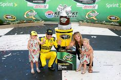 Picture perfect moment...family photo in victory lane!