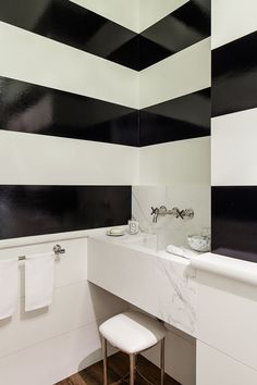 Love it! HIGH gloss paint - black and White stripes powder room