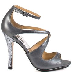 Fall in love with glamour all over again in this style from Badgley Mischka. Keyes brings you a dark silver shimmer fabric upper with criss cross straps and an adjustable ankle strap. This special occassion sandal is complete with a 4 inch glittering heel.