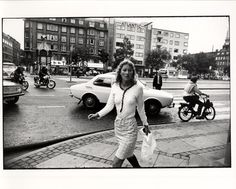 Garry Winogrand, Woman Walking with White Bag, Atlantic Building Behind