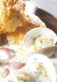Rhode Island Quahog Chowder   Yield: 1/2 gallon    6 quahog clams OR 2 cups of chopped clams  1 cup diced applewood smoked bacon  4 stalks celery, diced  1 medium Spanish onion, diced  3 ears fresh corn (cut off the cob)  3 Tablespoons all purpose flour  3 cups red potatoes, diced  1 quart fresh clam juice or canned  2 bay leaves  1 cup water  2 cups cream  About 1 teaspoon each of fresh chives and thyme  Salt and pepper