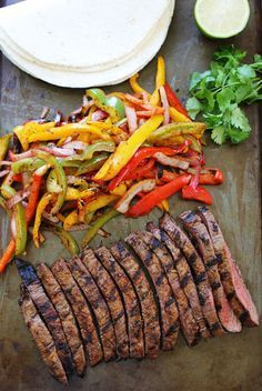 Grilled Steak Fajitas Recipe on twopeasandtheirpo. Get out the grill and make these easy and delicious fajitas for dinner! Fajita Grill, Easy Steak Fajitas, Steak Fajita Recipe, Grilled Steak Recipes, Beef Recipes, Cooking Recipes, Grilled Steaks, Chicken Fajitas, Chilis Copycat Recipes
