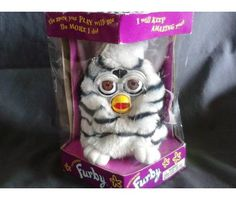 Unopened tiger furby collectible.