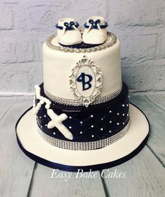 Beautiful Baptism navy and white themed cake. Bottom navy tier with quilting is a chocolate/caramel cake with a light white chocolate and butterscotch filling . Too tier is a yummy red velvet cake with white chocolate cheesecake buttercream filling .  Topped off with a cute little pair of handmade sugar shoes. #easy_bake_cake #choccaramel #redvelvet #baptismcake #sugarshoes #navyandwhite #acdnmember #muswellbrook