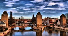 STRASBOURG, FRANCE Les Pont Couverts, a bridge that spans the River Ill and provides entrance to Strasbourg's Petite France, or old town Strasbourg, French Countryside, City Streets, Old Town, Cool Photos, Around The Worlds, Europe, France, Mansions