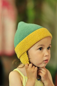 0eab102f3f5 The crochet toddler earflap hat is made in a washable dk weight  merino-cotton yarn -- perfect for a busy family!