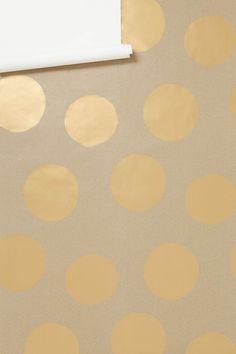 gold polka dot wallpaper from Anthropologie
