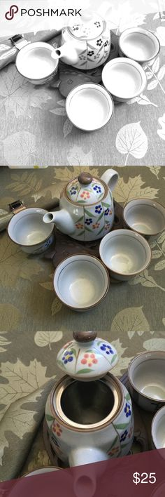 Japanese tea pot set for four 🍃🍁 Never used tea pot set from Japanese market. There is a strainer inside the tea pot, easy to use for loose leaf or tea bag. No damage chips or cracks. In perfect condition. I bundle and discount and will ship the same day. Other