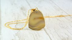 The delicate necklace with the natural agate pendant gold-plated on edges (electroplating) nickel and lead free. Long-lasting, anti tarnish plating.