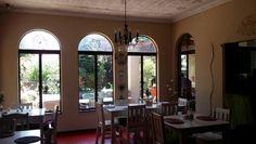 Arched windows at Die Boomhuisie.