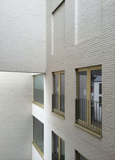 Housing and Social Centre Aarschot, Belgium - DRDH Architects Modern Residential Architecture, Brick Architecture, Commercial Architecture, Architecture Details, Interior Architecture, Facade Design, Exterior Design, Glazed Brick, Brick Facade