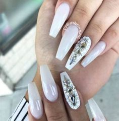 The white coffin nails trend is all the rage today. Overall, coffin nails are also referred to as ballerina nails. White Coffin Nails, Coffin Nails Long, Black Nails, White Nails, Rhinestone Nails, Silver Rhinestone, Prom Nails, Fun Nails, Nails Yellow