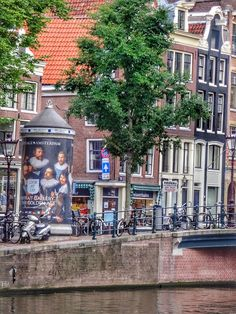 #amsterdamstroller:    A view from the Singel in Amsterdam. When strolling the canals you may see a view like this. Dont hesitate and just take a picture of that moment