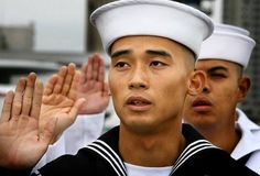 On the Midway's deck, military personnel take oath of citizenship by Tony Perry, latimes. Photo by Don Barletti. : Makos Chhay, 20, from Thailand takes the oath of citizenship on the flight deck of the Midway.