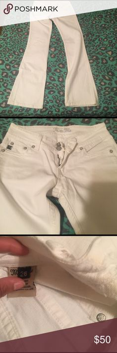Miss me jeans slight flare leg Almost perfect white and silver miss me jeans; small spot on back as pictured I have not ever worn the jeans so I'm not sure where that came from but I'm sure it can come out will drop price due to it other then that perfect condition size 26 Miss Me Jeans Flare & Wide Leg
