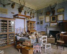 Calke Abbey in England. Sir Vauncey Harpur Crewe's Bedroom (above). It has been left in the state in which it was found in 1985, complete with hunting trophies, and collections of shells and fossils.