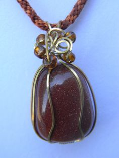 Gorgeous Goldstone Necklace wire wrapped with beading on a handmade Kumihimo cord. $30.00. Please check out my website www.miselaynesjewels.weebly.com for this or more of my pieces.