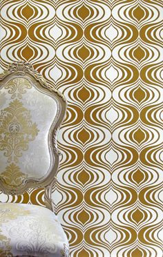 The new Vixen wallcovering by Phyllis Morris in metallic gold on white
