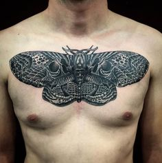 Pierroked creates an insane illusion in this black work tattoo. #Inked #tattoo #chest #Moth #insect #idea #ink #black #lines