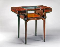 Walnut and mahogany tea table with glass center compartment; removable tea serving tray inside; Eugenio Quarti, 1914-15  The Wolfsonian–Florida International University, Miami Beach, Florida, The Mitchell Wolfson, Jr. Collection