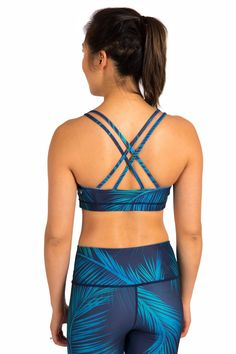 Inner Fire Palm Nights Explore Cross Sports Bra, Small. Eco-friendly material made from 88% recycled polylester and 12% spandex. Designed and printed with love in Vancouver BC. Super soft internal liner for extra coverage and cup liners offer light to medium support. Flattering cross back detail and flatlock seams for extra comfort. Ideal for use in yoga, running, swimming, or any kind of movement!.