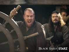 There's no one we'd rather follow into the jaws of death. This Sunday rally for your captain one last time.  | Toby Stephens as Captain James Flint and Luke Arnold as Long John Silver in Black Sails - Series Finale, Season 4 Episode 10