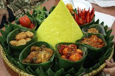 Indonesian tumpeng, serve for a special occasion. Yellow rice with its yummy side dishes