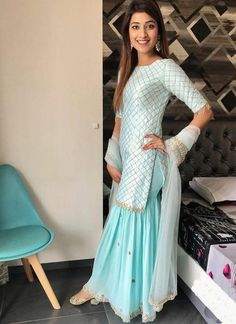Sky blue sharara-style suit paired with Luminous Gold Juttis Perfect for day weddings! Indian Gowns, Indian Attire, Indian Ethnic Wear, Pakistani Dresses, Sharara Designs, Kurti Designs Party Wear, Sarara Dress, The Dress, Indian Wedding Outfits