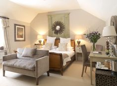 Soft hues in an inspiring Calcot Manor bedroom that features And So To Bed's hand carved Caned Corbiere bed.