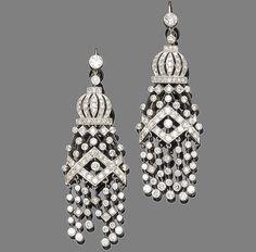 A pair of diamond pendent earrings  Each millegrain-set old brilliant-cut diamond surmount suspending a geometric openwork pendant set throughout with single-cut diamonds terminating in a similarly-set tassle, diamonds approx. 2.40ct total, length 6.5cm