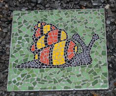 Stepping stone made with mosaic tiles - a nifty snail indeed.
