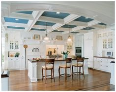 Trendy Kitchens. The ten-foot ceiling in refreshing white and ocean blue stretches from the kitchen through the breakfast room, family room and study in this Long Island Sound home. Sub-Zero and Wolf appliances were integrated including a pizza oven. Photograph by Tim Lee Photography. Photo courtesy of Sub-Zero/Wolf.