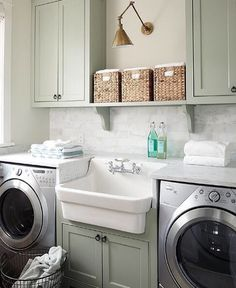6 utility room package in glacier white with stacked washer and laundry room sink american standard sink installed between a whirlpool washer and dryer urban grace interiors via atticmag solutioingenieria Choice Image