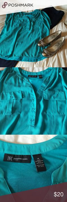 1X sleeveless top Turquoise and green sleeveless top. Knit (rayon) back and polyester front. Light, airy and super cute for work or play. Looks greats with tan or navy trousers for work! Great layering piece! Whole outfit pictured is for sale!!! Smoke free home. INC International Concepts Tops Blouses