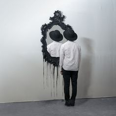 This photo is creepy in the best way. It is something so different that it makes you stop and stare for a moment. I love the black and white as well as the excess space around the man and mirror that give the image a clean appearance and simplify the image a bit.
