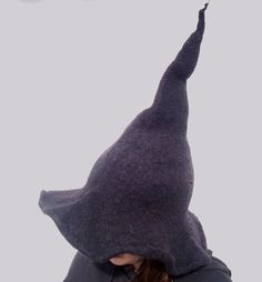 Knit yourself a hat that feels and looks like a REAL witch's hat complete with quirky peak. The hat is knitted and then felted. The felting process transforms the knitted fabric into a firm felt that gives the hat its shape. Felt Witch Hat, Witch Hats, Diy Witch Hat, Knitting Patterns, Crochet Patterns, Hat Tutorial, Real Witches, Felt Diy, Yarn Crafts