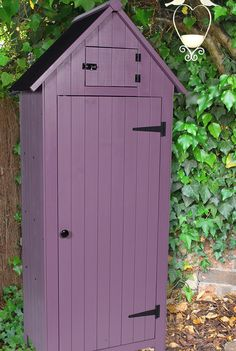 Affordable Garden Designs for Outdoor Living - Sue Ryder | as with our indoor spaces, there's always the need for storage no matter how small or large an outdoor space you have. Thiscompact vintage plum Sentry Shedis ideal don't you think? Whether it's for storing pots and having your most used tools to hand, it's useful but also pretty shed that I wouldn't say no to in my garden. #gardeninspo #gardenideas #gardenstorage #outdoorliving #outdoorstorage #storageideas #garden