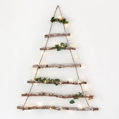 "Birch Branch Hanging Christmas Tree ~ ""Crafted from natural birch branches and sprinkled in glitter snow, this hanging tree is perfect for creating a Scandinavian feel at home this Christmas."""