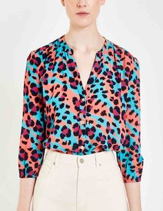 Pyrus Solace blouse - litmus animal - Our bestselling Solace blouse from Pyrus in animal print in black and fuchsia pink on a blue and coral base. Clothes For Sale, Dresses For Sale, Dress Outfits, Fashion Dresses, Blouses Uk, Feather Stitch, Easy Shape, Pyrus, Blouse Dress