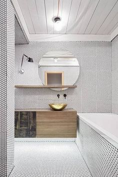 Photo 1 of 7 in Step Aside, Subway Tile—Penny Tile Is the New Classic from A Sleek Kitchen and Double Bathroom Renovation in Prague - Dwell Bad Inspiration, Bathroom Inspiration, Bathroom Interior, Home Interior, Design Bathroom, Bathroom Trends, Penny Tile Floors, Round Wall Mirror, Wall Mirrors