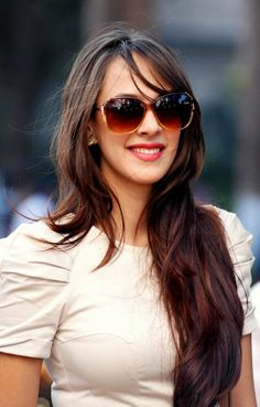 Hazel Keech smiles brightly for the paparazzi.